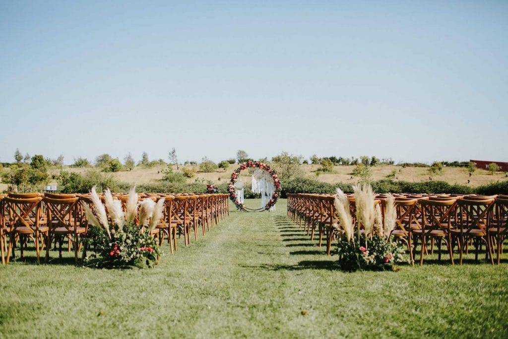 outdoor wedding ceremony setup with chairs on a field of grass at the ethereal open air resort in san diego