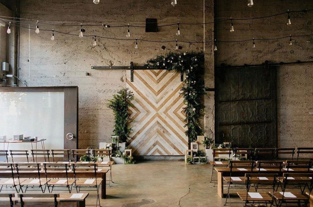 industrial ceremony setup with twinkle lights in luce loft in san diego