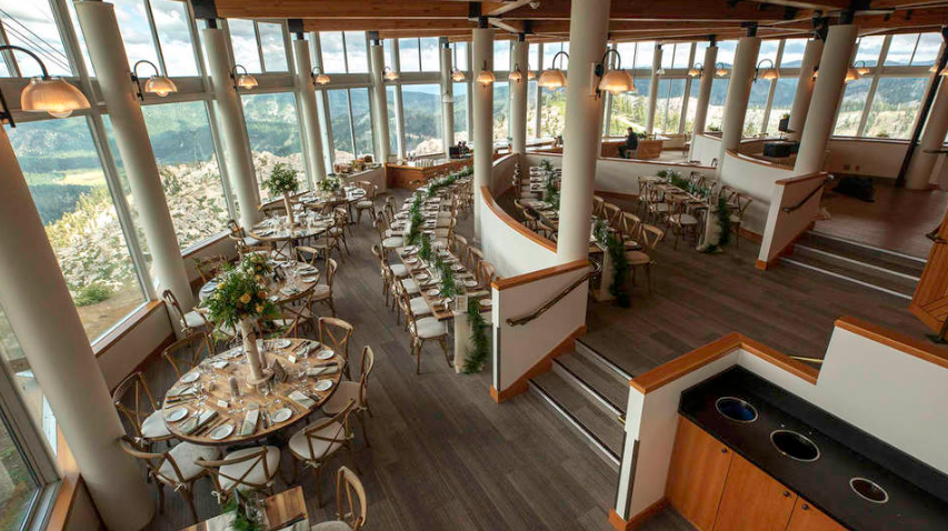 wedding reception tables set up in the terrace room at high camp at squaw valley alpine meadows