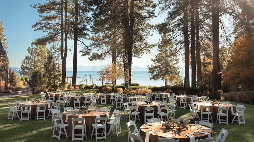 tables for a wedding reception set up on a lawn by the lake at the hyatt regency lake tahoe resort, spa and casino
